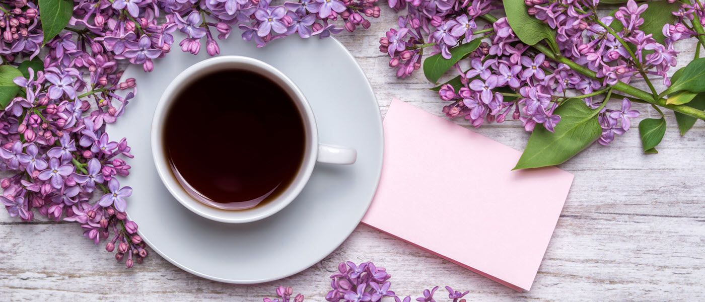 cup of coffee and lilacs
