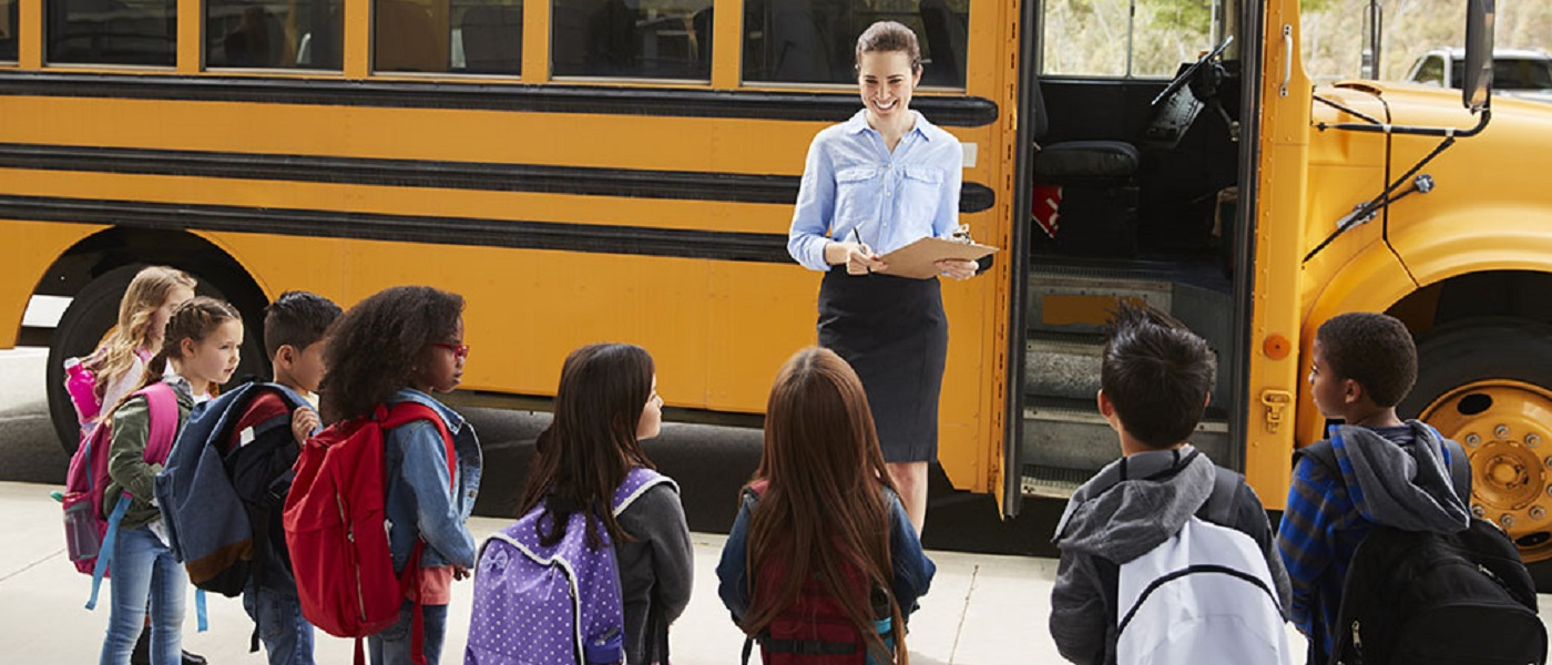 School children wailting to get on bus