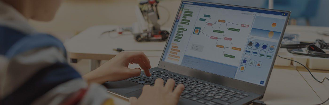Student using laptop to create diagram