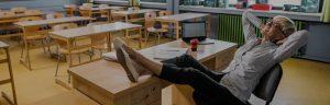 teacher relaxing in classroom