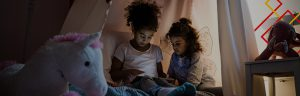Girls reading on tablet
